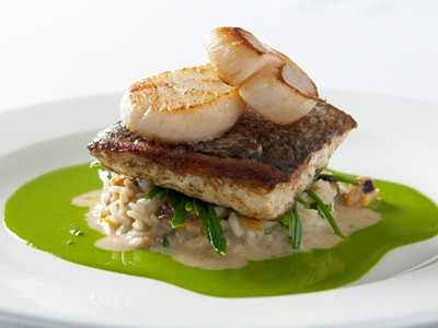 Savour gourmet cuisine in The Brasserie on the Bay