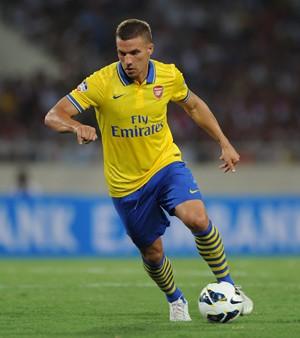 Arteta and Podolski Emirates 2012